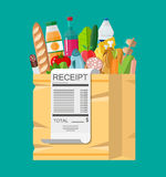 Shopping bag full of groceries and receipt. Shopping bag full of groceries products and receipt. Grocery store. Supermarket. Fresh organic food and drinks Royalty Free Stock Images