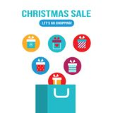 Shopping bag with gift boxes flying out of it New Year Christmas sale Stock Image