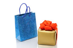 Shopping bag and gold present Stock Photo