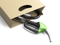 Shopping bag with green fuel pump nozzle. Royalty Free Stock Image