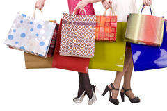 Shopping bag and group of leg in shoes. Stock Photo