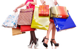 Shopping bag and group of leg in shoes. Stock Images