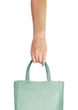 Shopping bag in hand - Consumerism symbol Royalty Free Stock Images