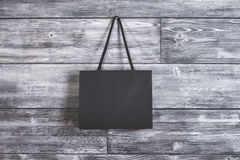 Shopping bag hanging on wall Stock Images