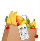 Shopping bag with healthy fruit and a nutrient label. Stock Photos