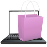 Shopping Bag on Keyboard of Laptop to Shop Online Stock Photography