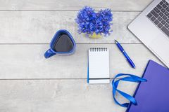Shopping bag, laptop, notepad on wooden desk royalty free stock photo