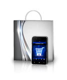 Shopping bag and mobile phone isolated over white Royalty Free Stock Photos