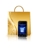 Shopping bag and mobile phone isolated over white Royalty Free Stock Photo