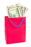 Shopping bag with money. Isolated on white background royalty free stock photos