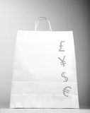 Shopping bag with money sign. Photo of white shopping bag with money sign isolated on gray background, successful business, foreign money symbol, paper present Royalty Free Stock Photography