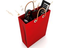 Shopping bag with musical equipments Royalty Free Stock Photography