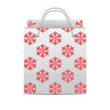 Shopping bag with a pattern of snowflakes Royalty Free Stock Photos