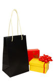 Shopping bag and presents Royalty Free Stock Photos