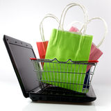 Shopping bag with purchase on computer Royalty Free Stock Images