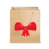 Shopping bag and red bow isolated on white Royalty Free Stock Image