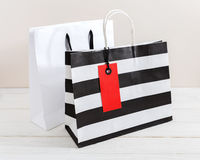 Shopping bag with red tag Stock Photo