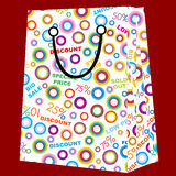Shopping-bag with sale announcements Stock Images