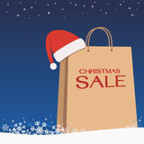 Shopping bag santa clause hat on snow blue background Stock Image