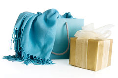 Shopping bag with scarf and gift box. Shopping bag with blue scarf and golden gift box isolated on a white background Royalty Free Stock Images