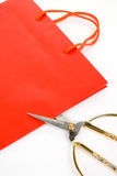 Shopping Bag and scissor stock images