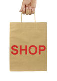 Shopping bag with SHOP text and isolated on white background. Royalty Free Stock Image