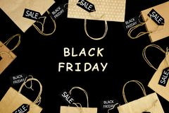 Shopping bag from shopping mall. Fashion black friday holiday. Craft paper shopping bag on black isolated background with wooden text `Black Friday` and sale stock photo