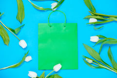 Shopping bag and tulips Royalty Free Stock Photos