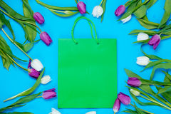 Shopping bag and tulips Stock Images