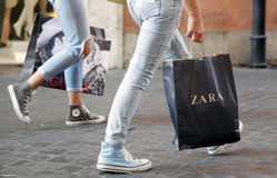Shopping bag. Two young girls walk with their Zara shopping bag on Via Ripetta, main shopping street in the center of Rome, Italy stock images