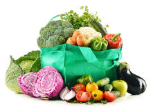 Shopping bag with variety of fresh organic vegetables Royalty Free Stock Photos