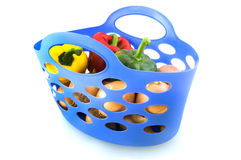 Shopping bag with vegetables. Blue shopping bag with vegetables isolated on white background stock photo