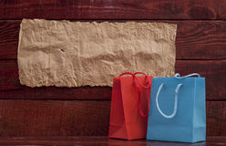 Shopping bag on wooden background Royalty Free Stock Photo