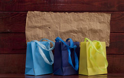 Shopping bag on wooden background Royalty Free Stock Image