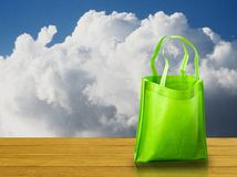 Shopping bag on wooden table Royalty Free Stock Image