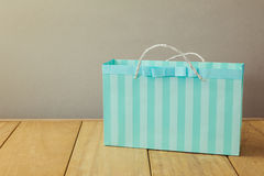 Shopping bag on wooden table Stock Photography