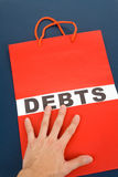 Shopping Bag and word debts Stock Images