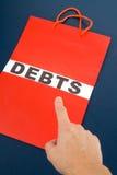 Shopping Bag and word debts Royalty Free Stock Image