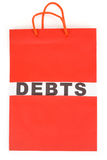 Shopping Bag and word debts Royalty Free Stock Photo