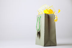 Shopping bag with yellow bows. Royalty Free Stock Photography