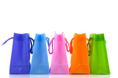 Shopping bags. A row with colorful shopping bags with white background royalty free stock image
