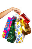 Shopping bags. Woman hand with shopping bags. Isolated over white. Christmas Shopping Series stock images