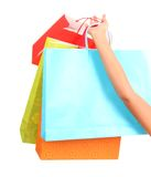 Shopping bags. Closeup of  held up by woman. Isolated on white stock images
