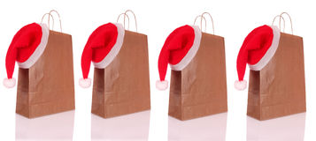 Shopping bags. Paper shopping bags with a Christmas hat on white background Stock Photography
