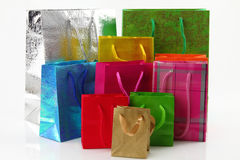Shopping bags. Multi colored shopping bags over white background royalty free stock photography