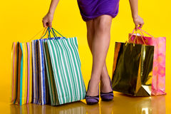Shopping bags. Female hands holding shopping bags Stock Images
