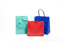 Shopping bags. Three colored shopping bags with handles royalty free stock images