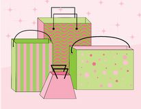Shopping Bags. Four feminine pink and green shopping bags Stock Photos