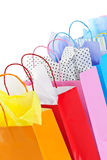 Shopping bags. Many colorful shopping bags on white background royalty free stock photos