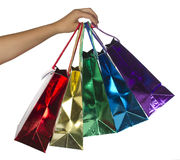 Shopping bags. In female hand isolated over white Royalty Free Stock Photo